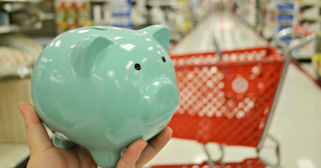 mint colored piggy bank in front of target cart