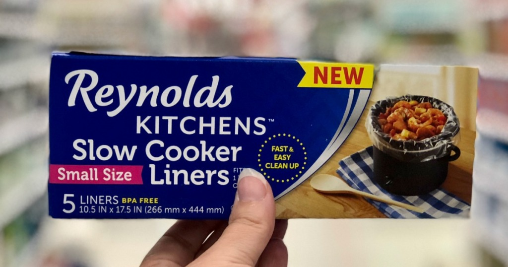 hand holding box of Reynolds Slow Cooker Liners