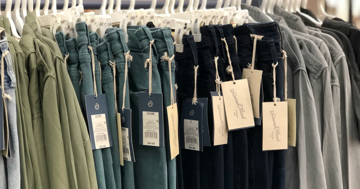 Rack of Universal Thread Jeans with tags hanging