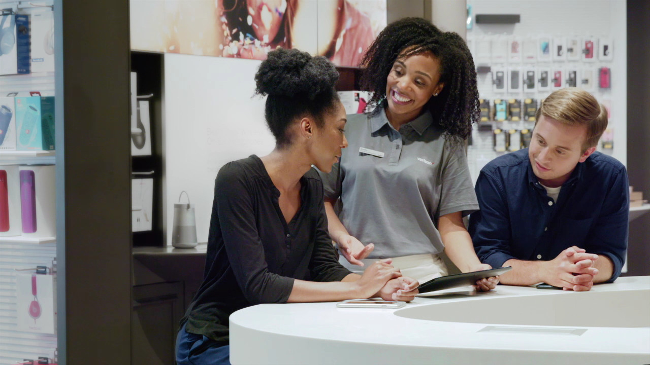 Verizon store front with customer service professional