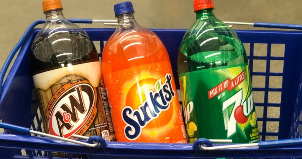 a&w, sunkist, 7up 2-liters in blue shopping basket