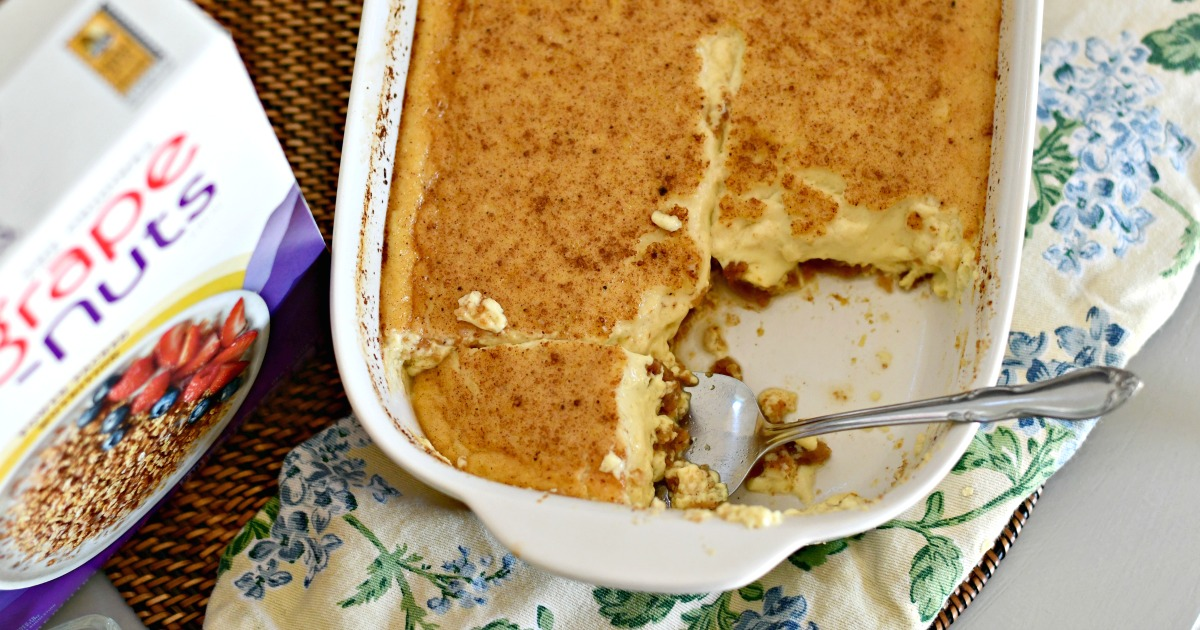 Classic Grape-Nuts Pudding in the bakeware with a serving spoon