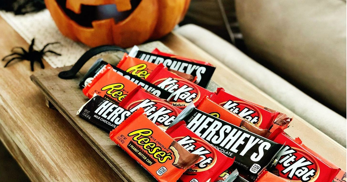 wooden tray full of full size Hershey candy bars