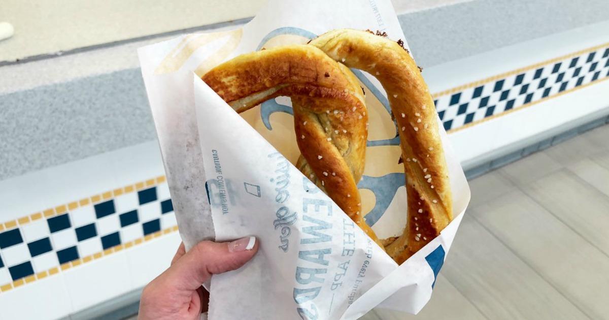 hand holding a salted auntie annes pretzel