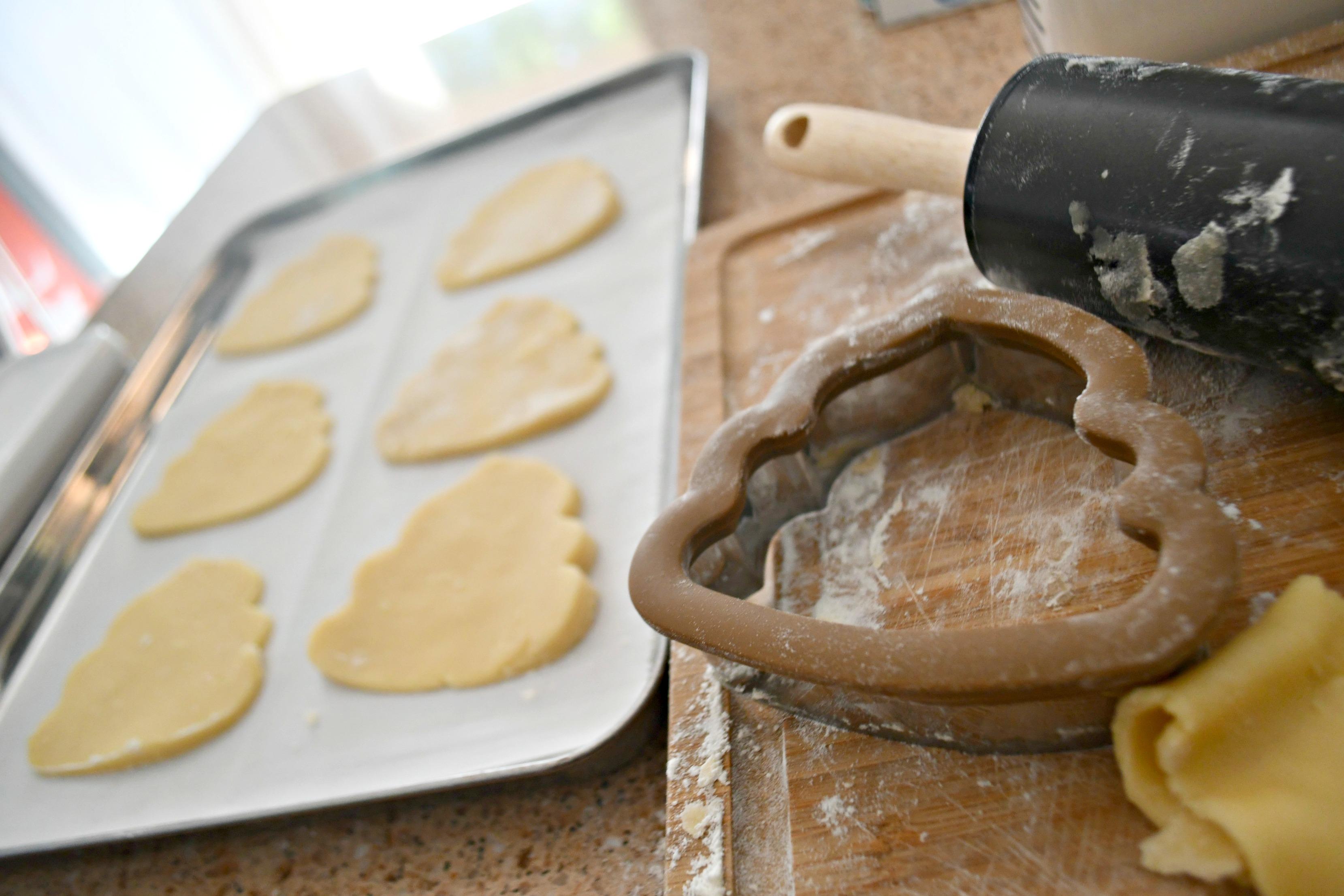 DIY Poop Emoji Santa Christmas Cookies – on a baking sheet