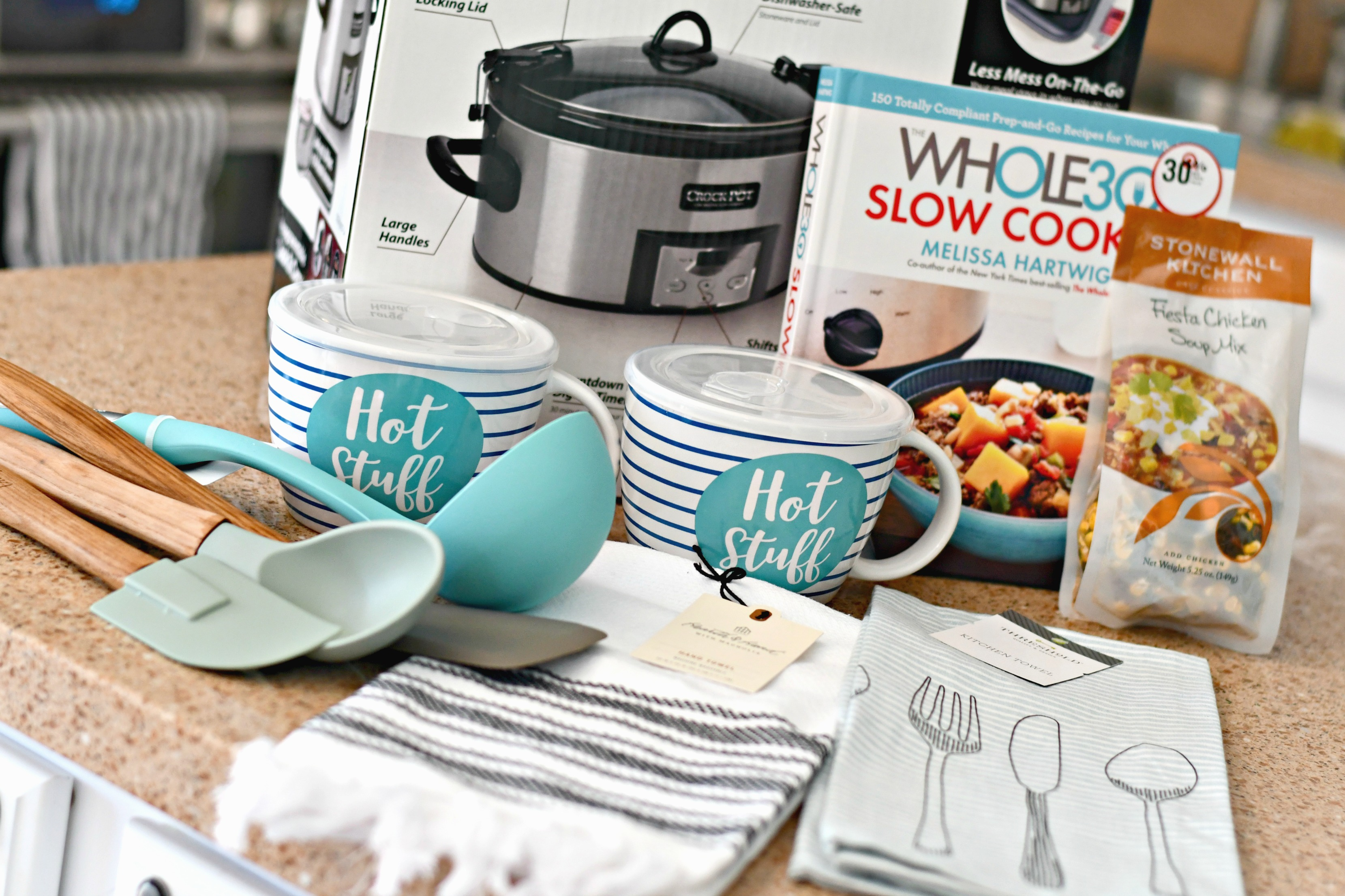 diy gift slow cooker gift basket – serving spoons, towels, cookbook, packet, and slow cooker