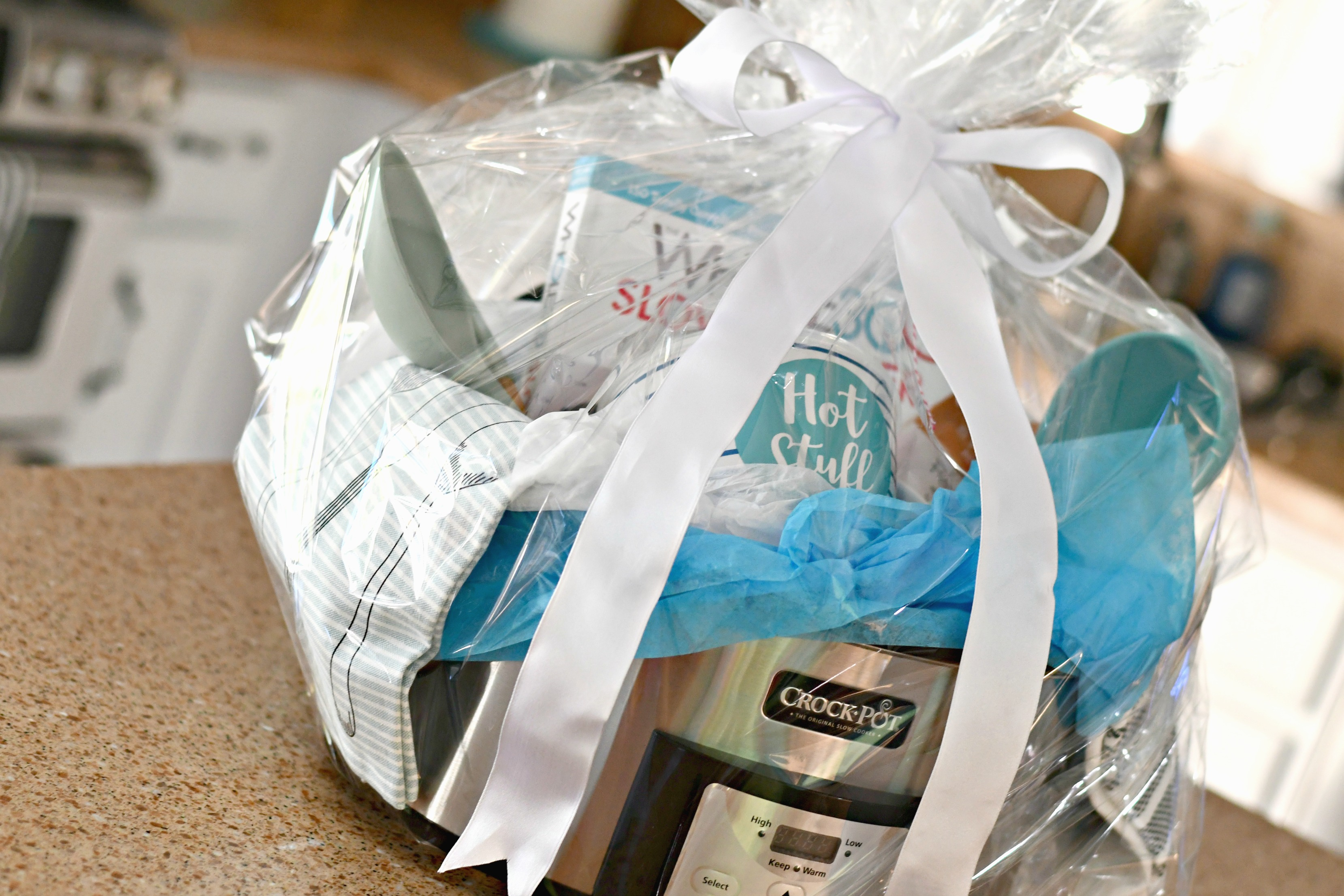 diy gift slow cooker gift basket – All wrapped with clear plastic and a bow