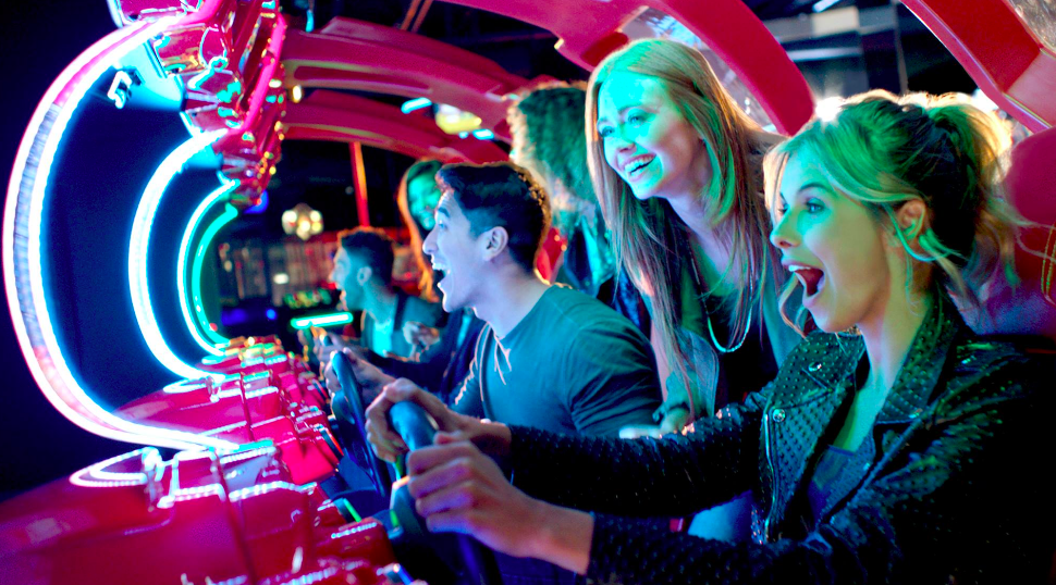 adults playing dave and busters games