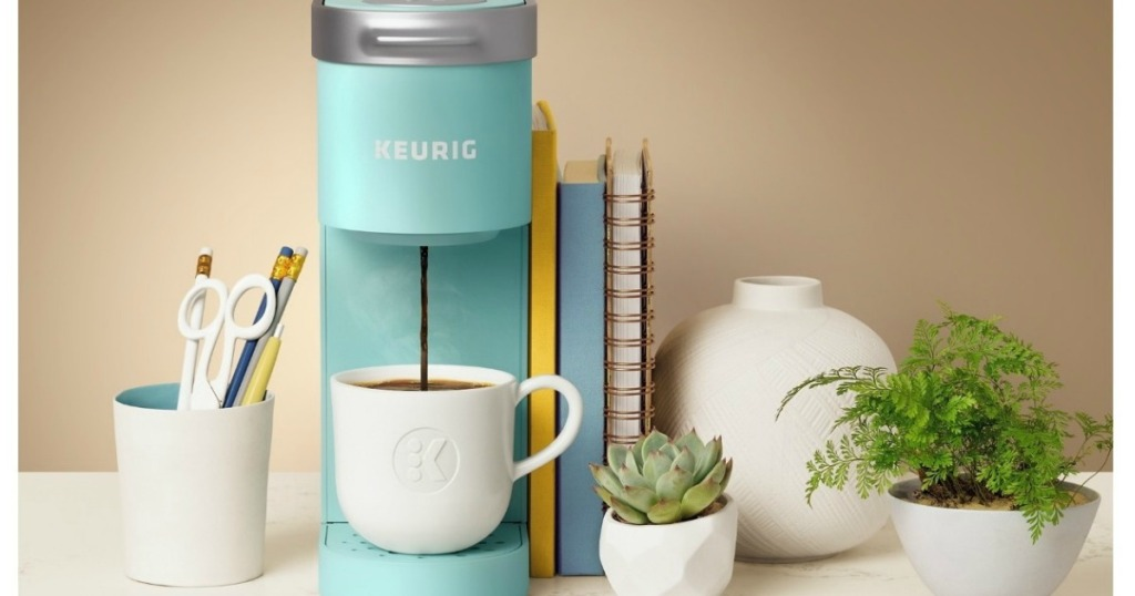 Keurig K-Mini Single Serve Coffee Maker brewing coffee into a mug on counter