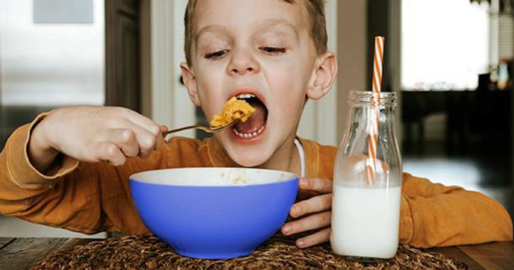 boy eating Kraft Mac & Cheese from a bowl