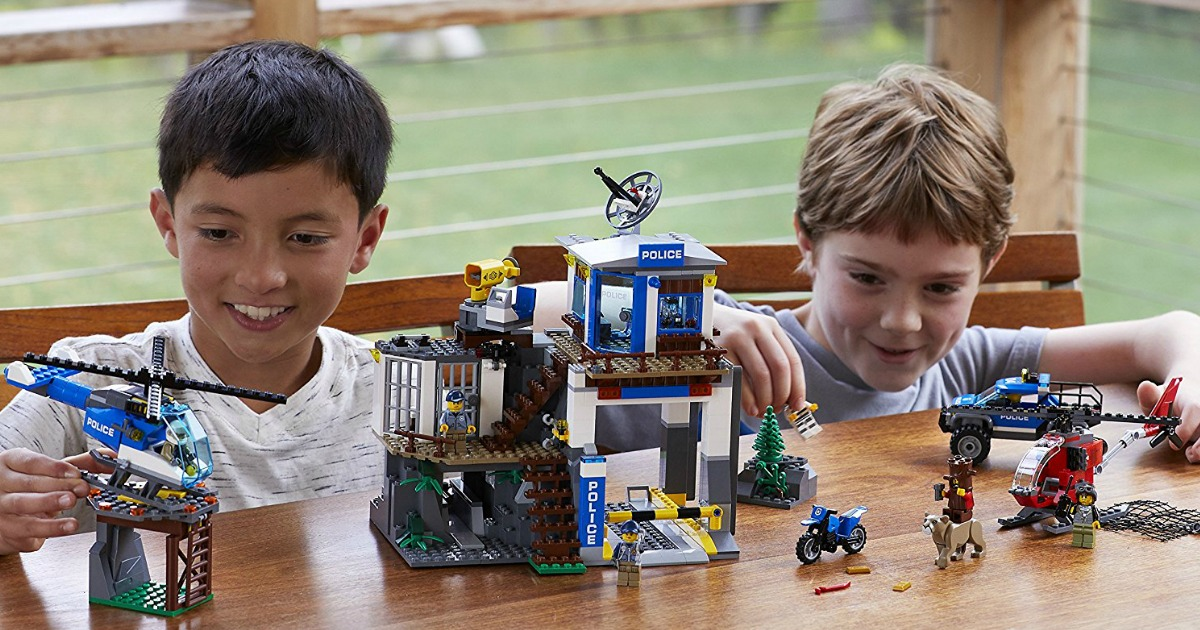 boys playing with LEGO City Police Mountain Police Headquarters