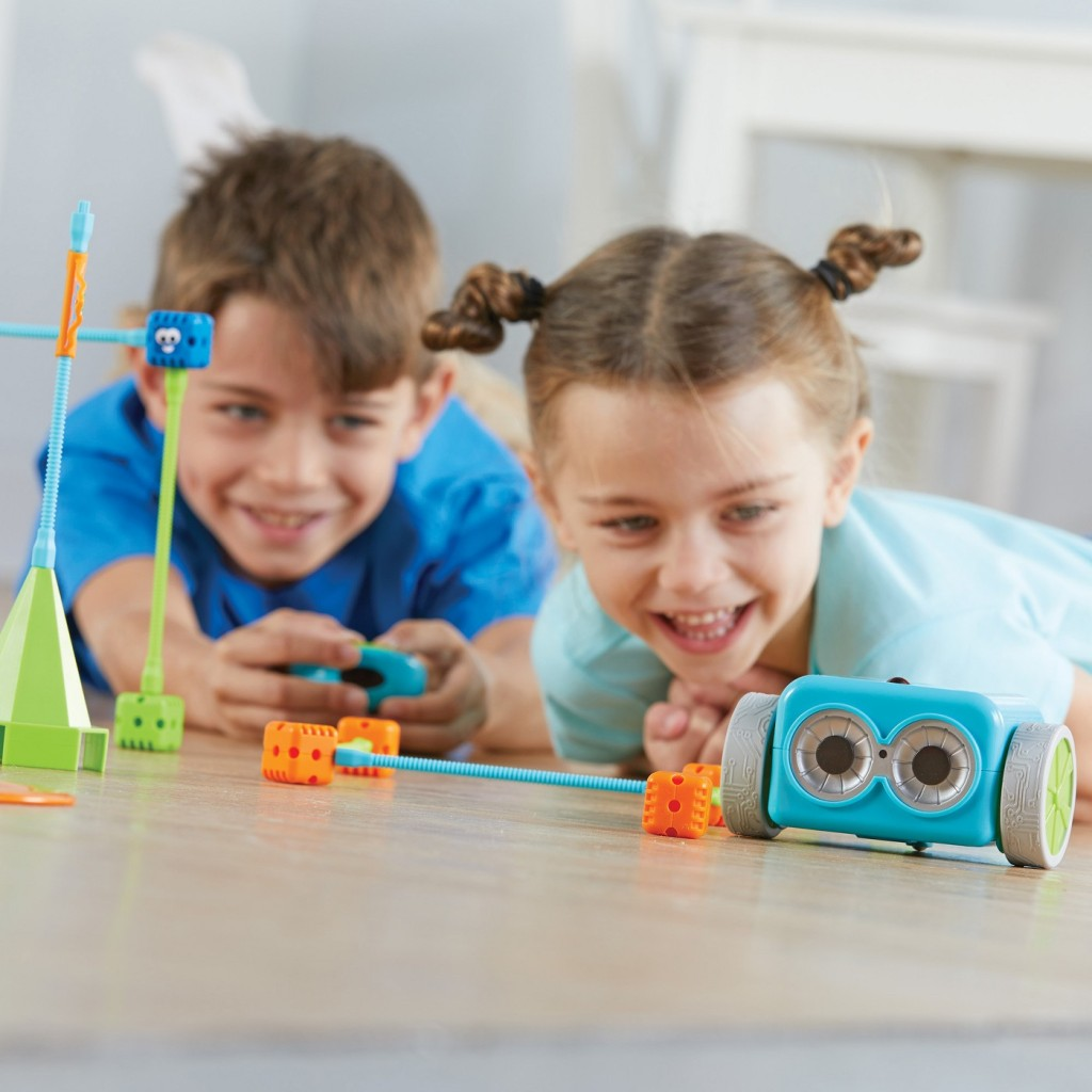 kids playing with botley coding robot