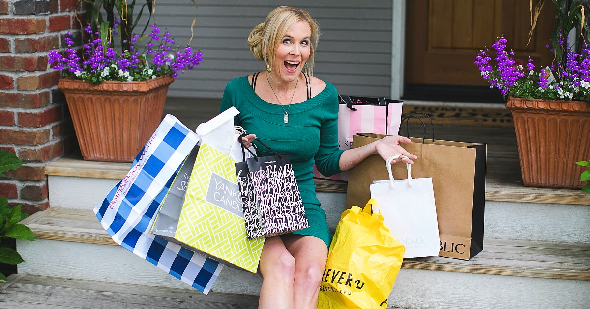http://gift%20guides%20ideas%20tips%20–%20collin%20holding%20shopping%20bags