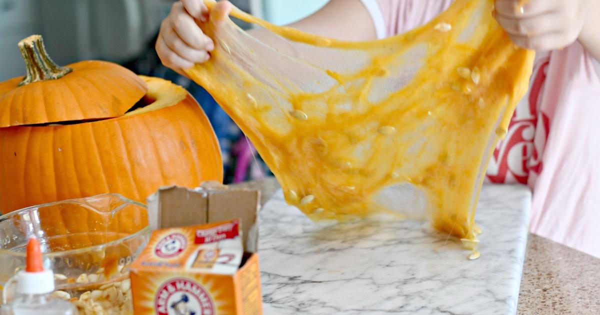 DIY Pumpkin Guts Slime – the slime being pulled apart
