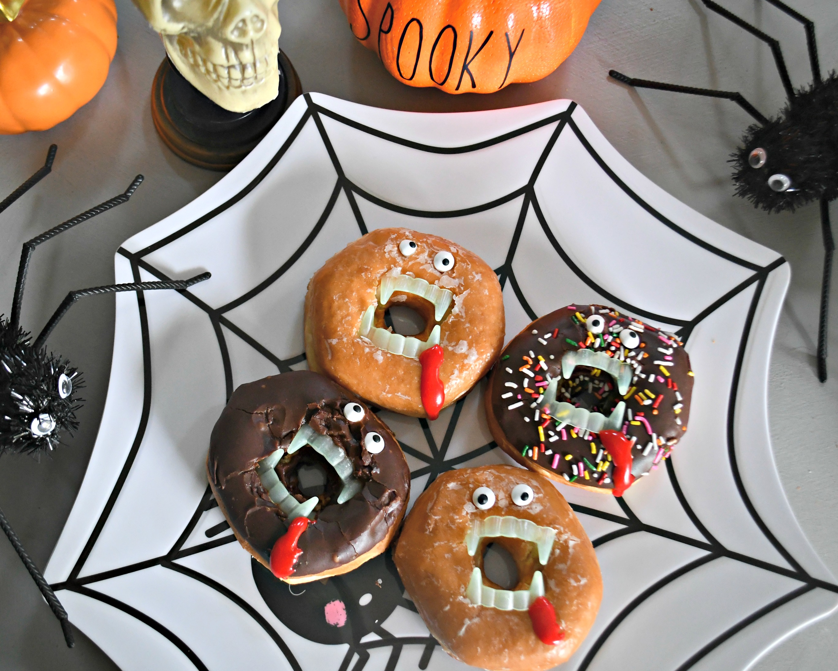 These Spooky Vampire Donuts Halloween Treats are an easy and fun idea – displayed on a plate