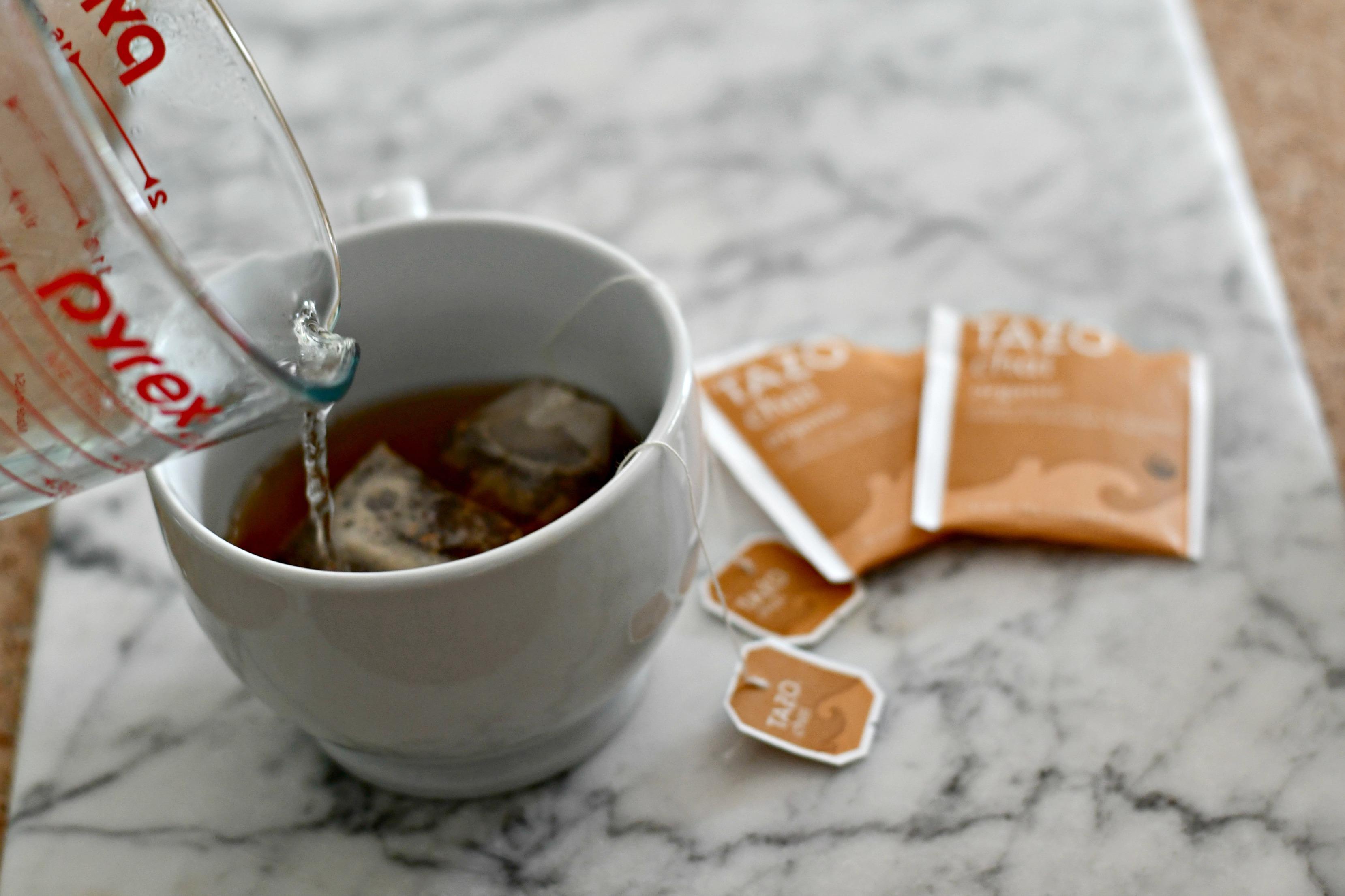 Pouring the diy starbucks chai latte into a mug