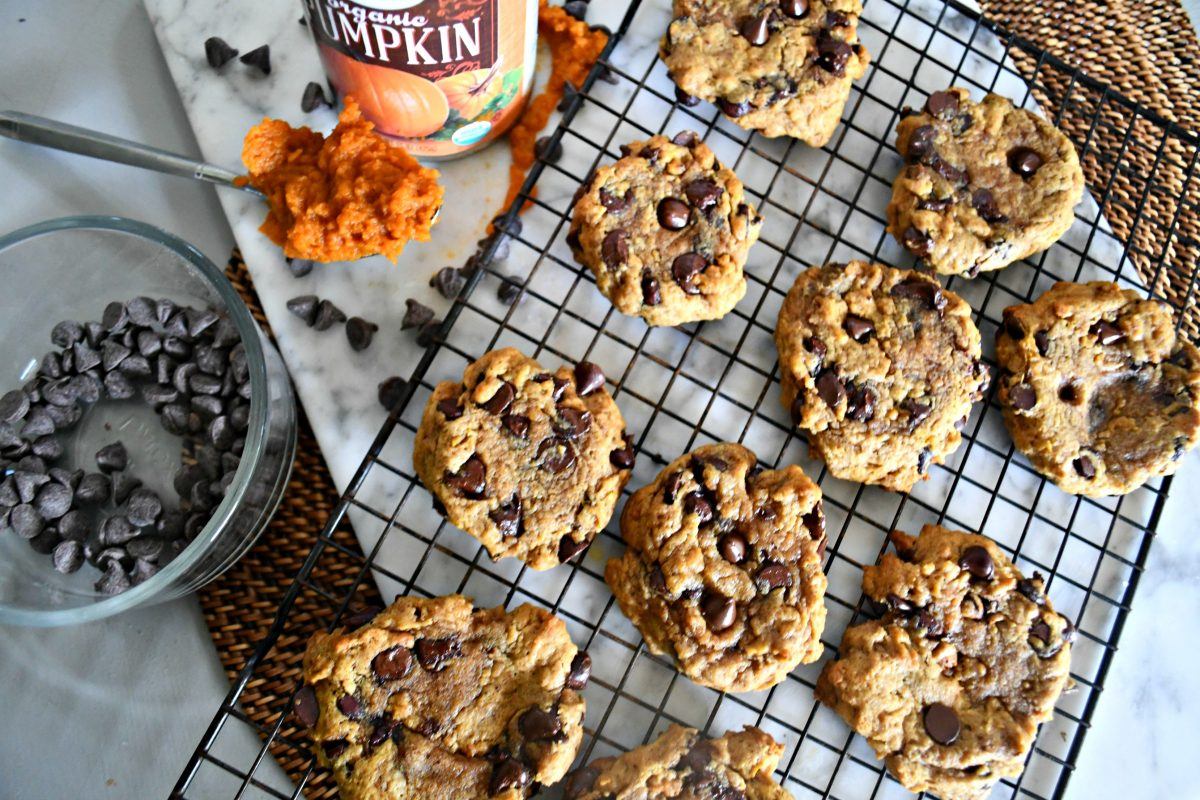 Pumpkin Chocolate Chip Cookies – on a cooling rack with pumpkin and chocolate chips nearby