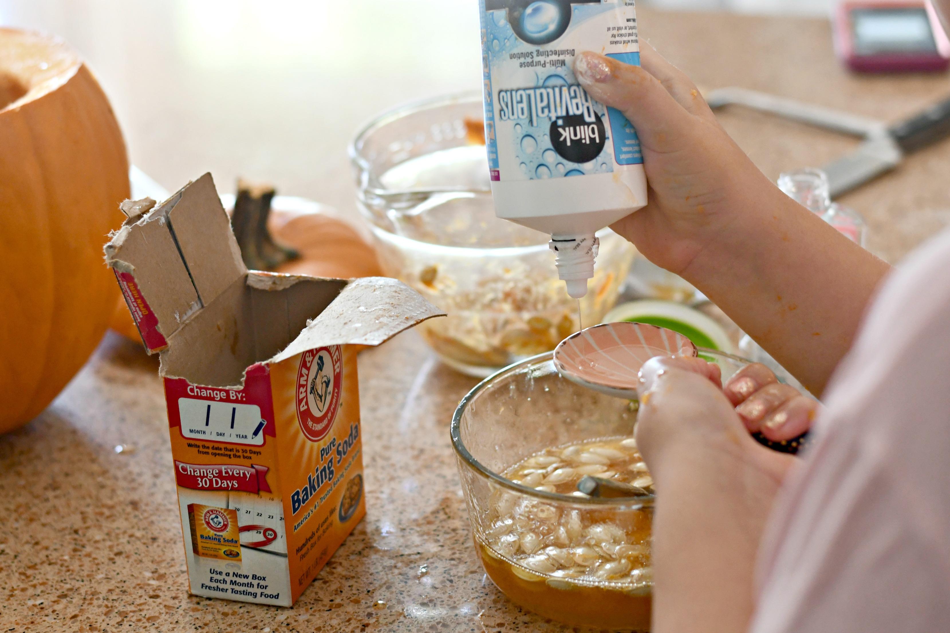 DIY Pumpkin Guts Slime – mixing ingredients