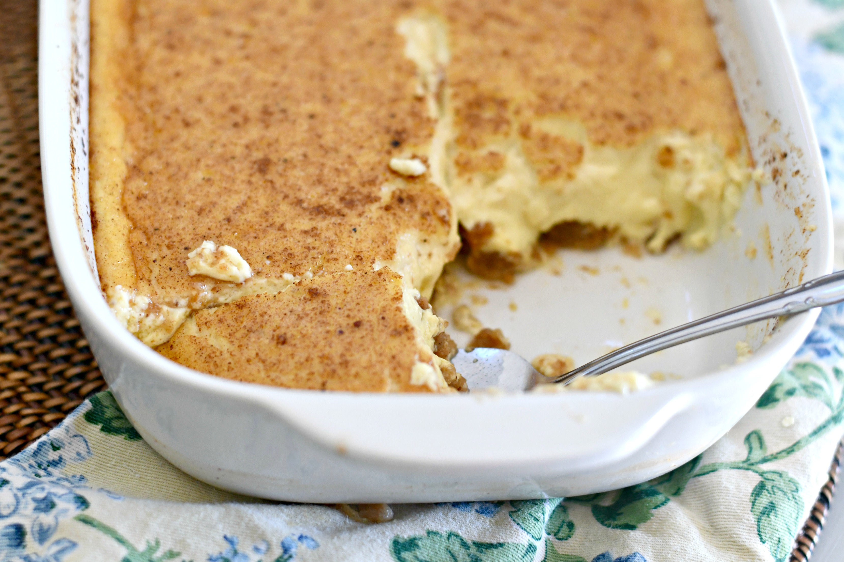 Classic Grape-Nuts Pudding closeup with a serving gone to show the pudding inside