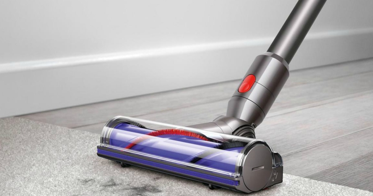 dyson vac being used on a carpet