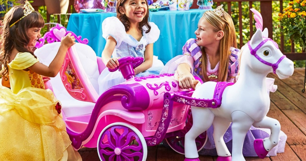 kids playing with the disney ride on carriage toy