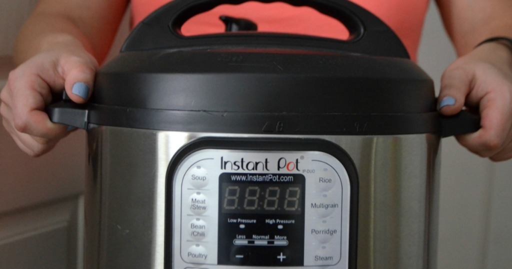 woman holding Instant Pot