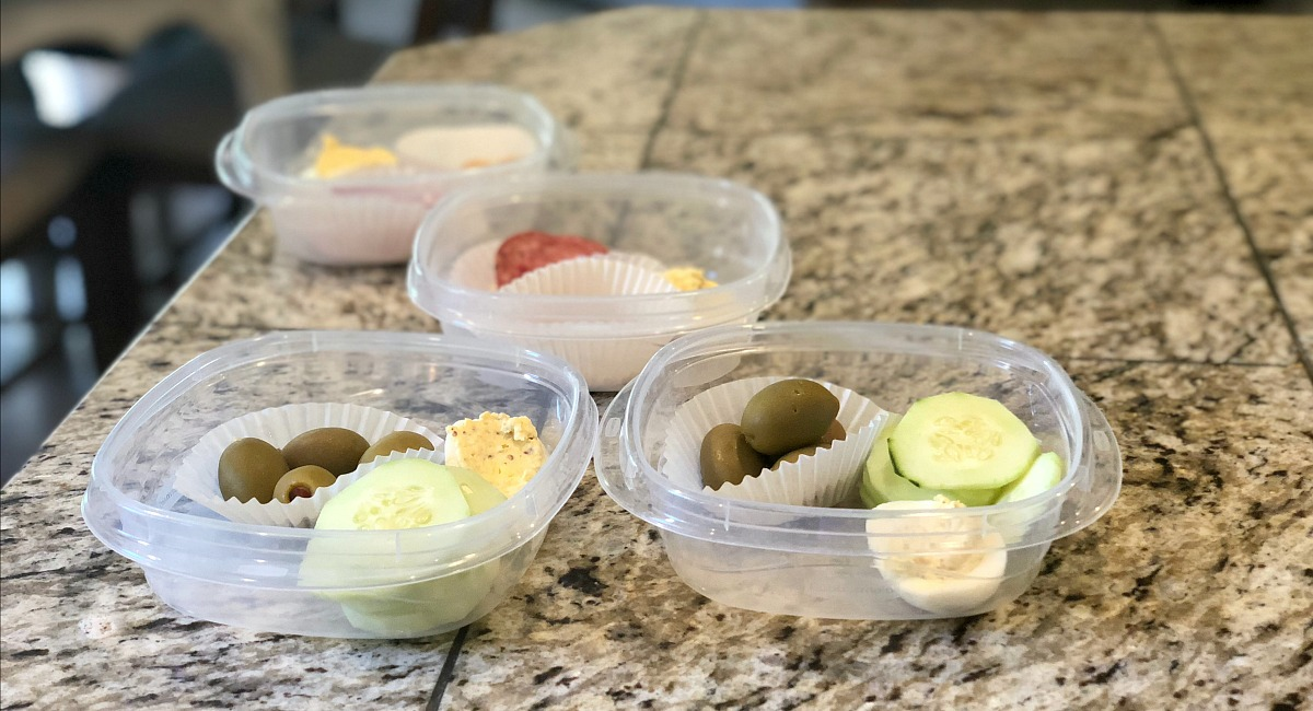 vegetarian meal planning tips for a meat-loving family – low carb snacks of olives, hard-boiled eggs, and cucumbers