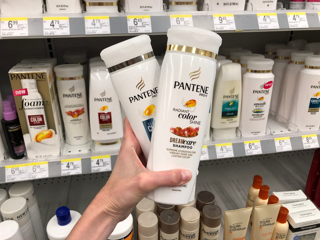 two bottles of pantene criss-crossed in hand
