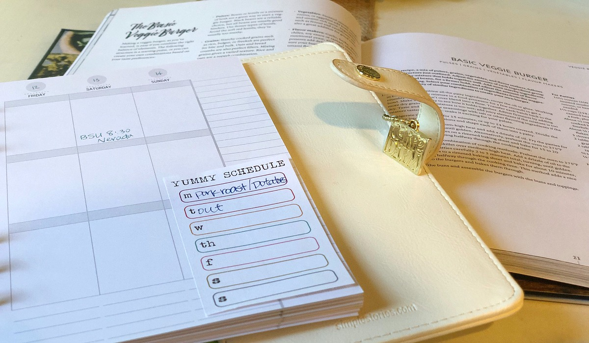 vegetarian meal planning tips for a meat-loving family – planner with recipe books planning meals