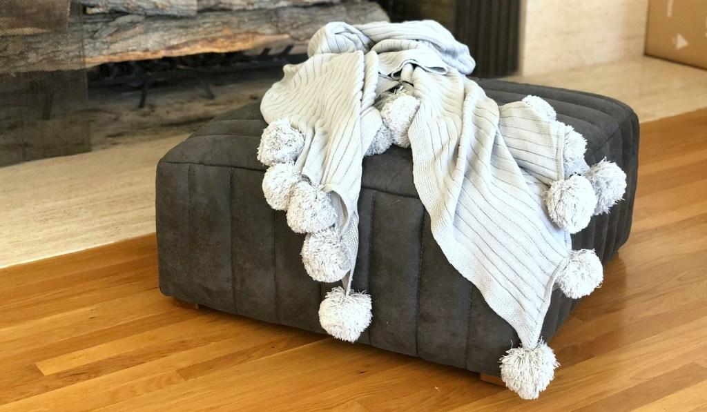 homebody gift guide — pom pom blanket