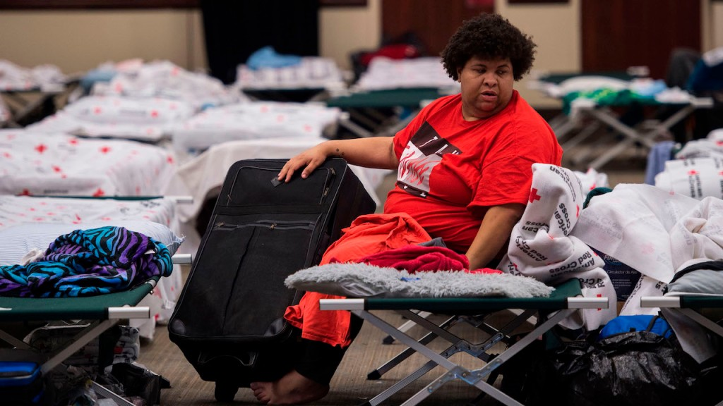 Volunteer at a shelter to help hurricane recovery efforts