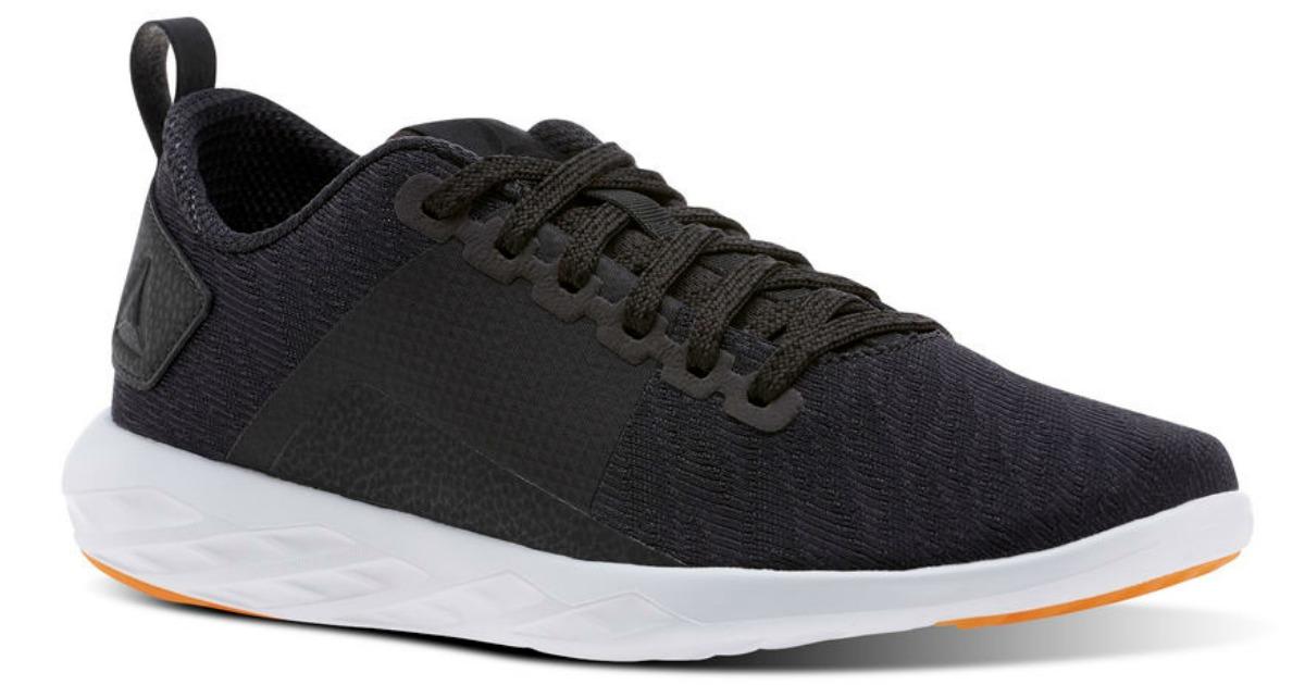 Reebok women's shoe in navy blue stock image