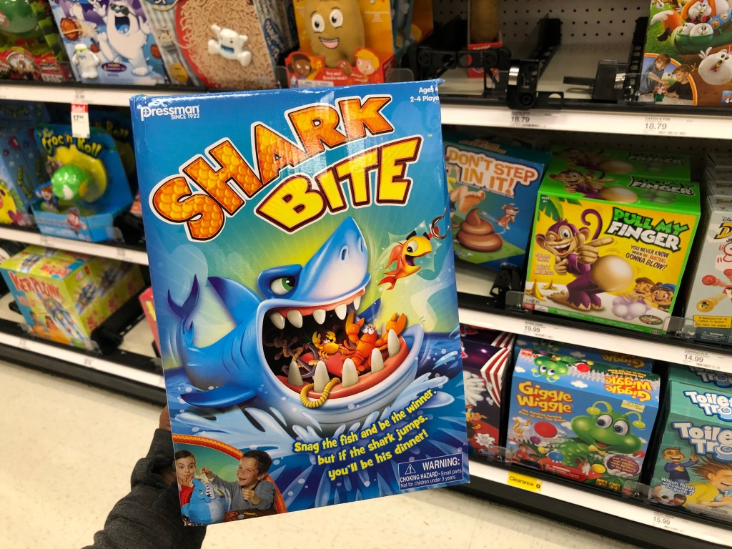 hand holding shark bit game with games in background
