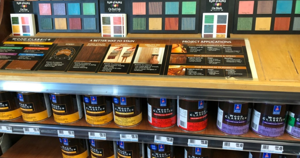 Sherwin Williams Wood Classics paints on shelf with samples