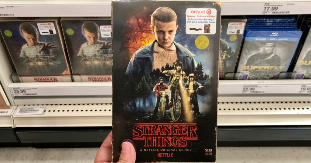 hand holding stranger things blu-ray at target
