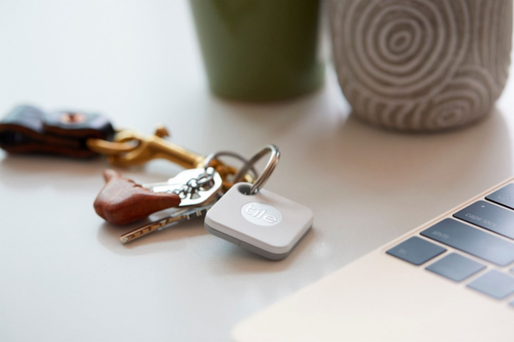Tile Tracker attached to keychain on counter
