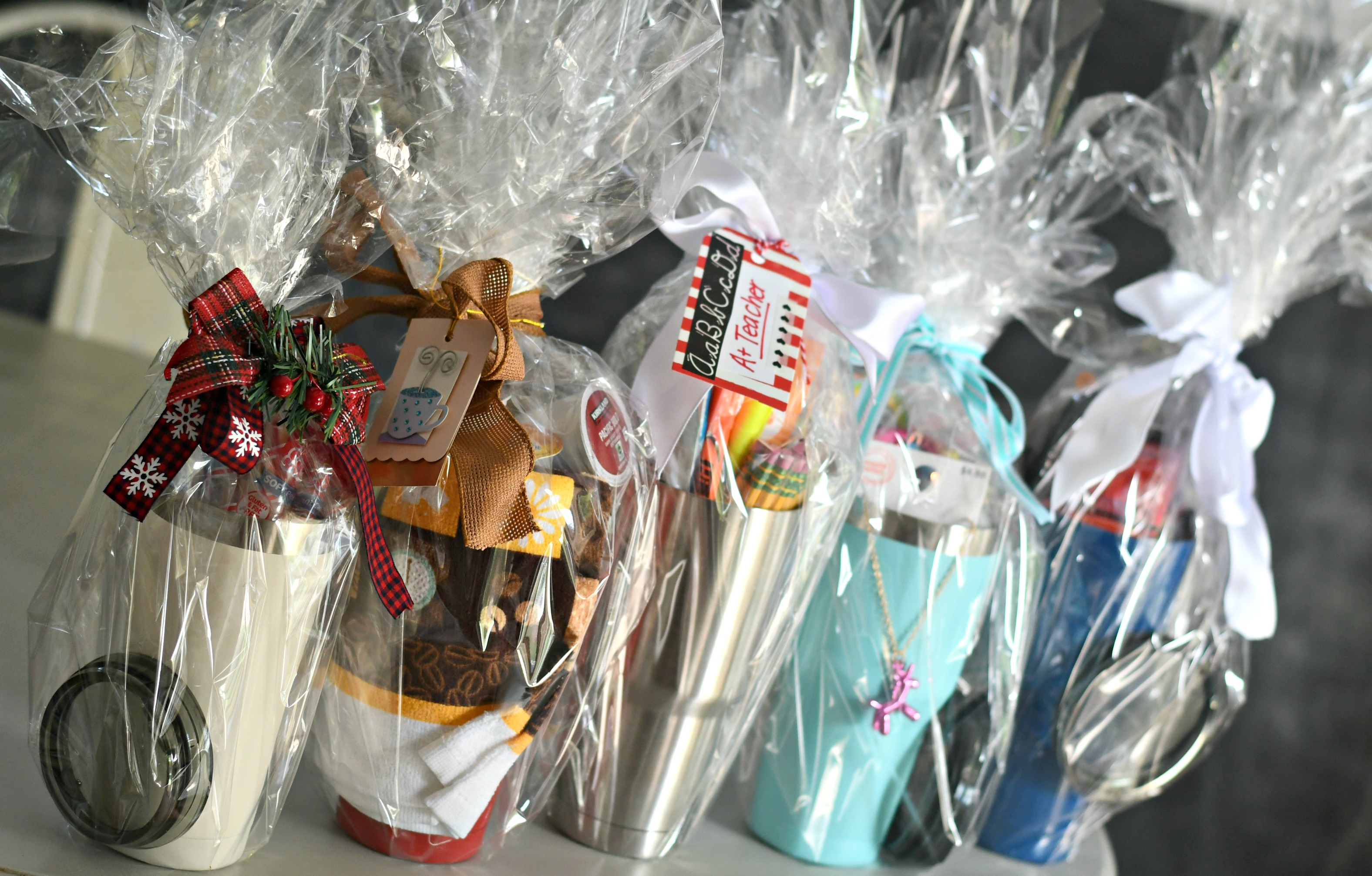 DIY Tumbler Gift basket ideas – tumblers wrapped in cellophane with cards and ribbon