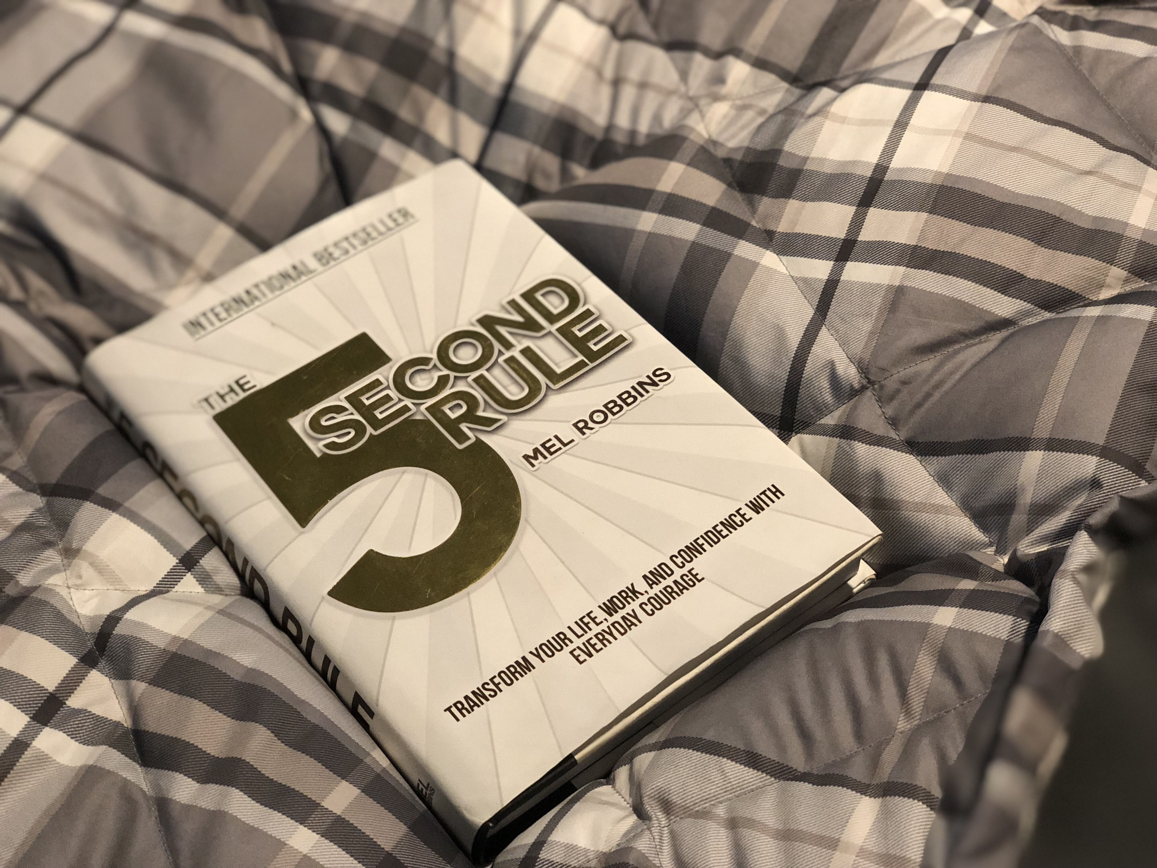 changed life 5 seconds – closeup of the book The 5 Second Rule by Mel Robbins on the bed