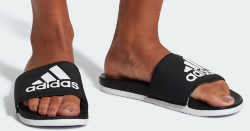 b93f38cdbb96 Hop on over to Adidas.com where select Adidas Men s and Women s Adilette  Cloudfoam Slides are on sale for  18 shipped (regularly  35).
