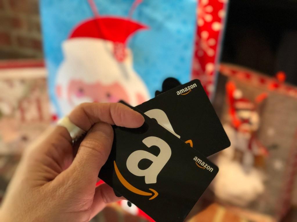holding amazon gift cards