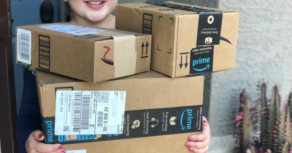 girl holding Amazon Packages
