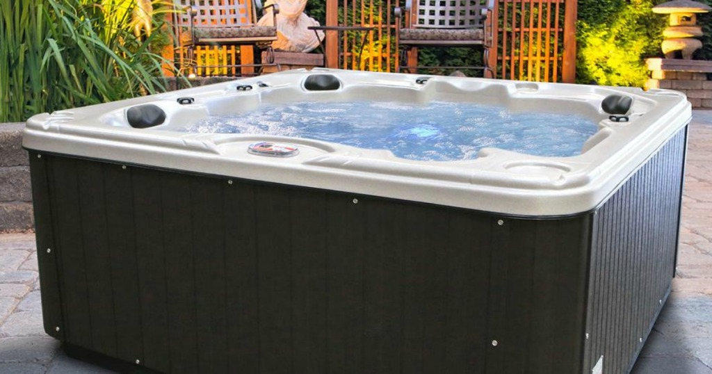 American Spas Glory 7-Person 40-Jet Premium Acrylic Lounger Spa Hot Tub on patio