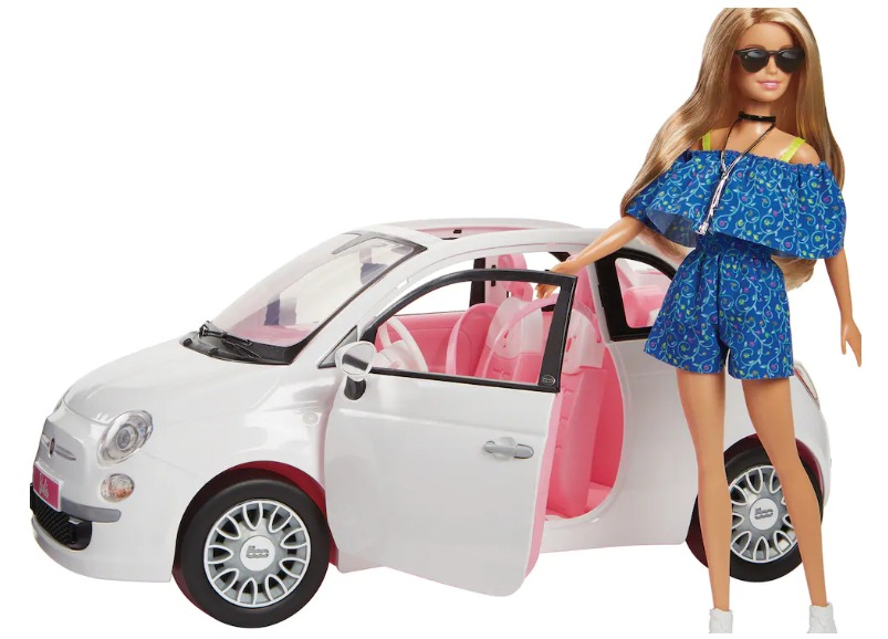 Barbie standing next to a car