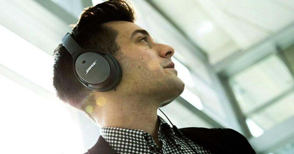 guy wearing bose headphones