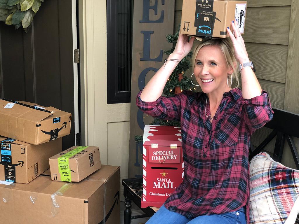 woman putting Amazon box on her head