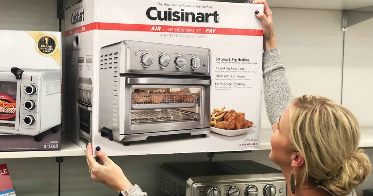 Collin grabbing Cuisinart Toaster box from store shelf