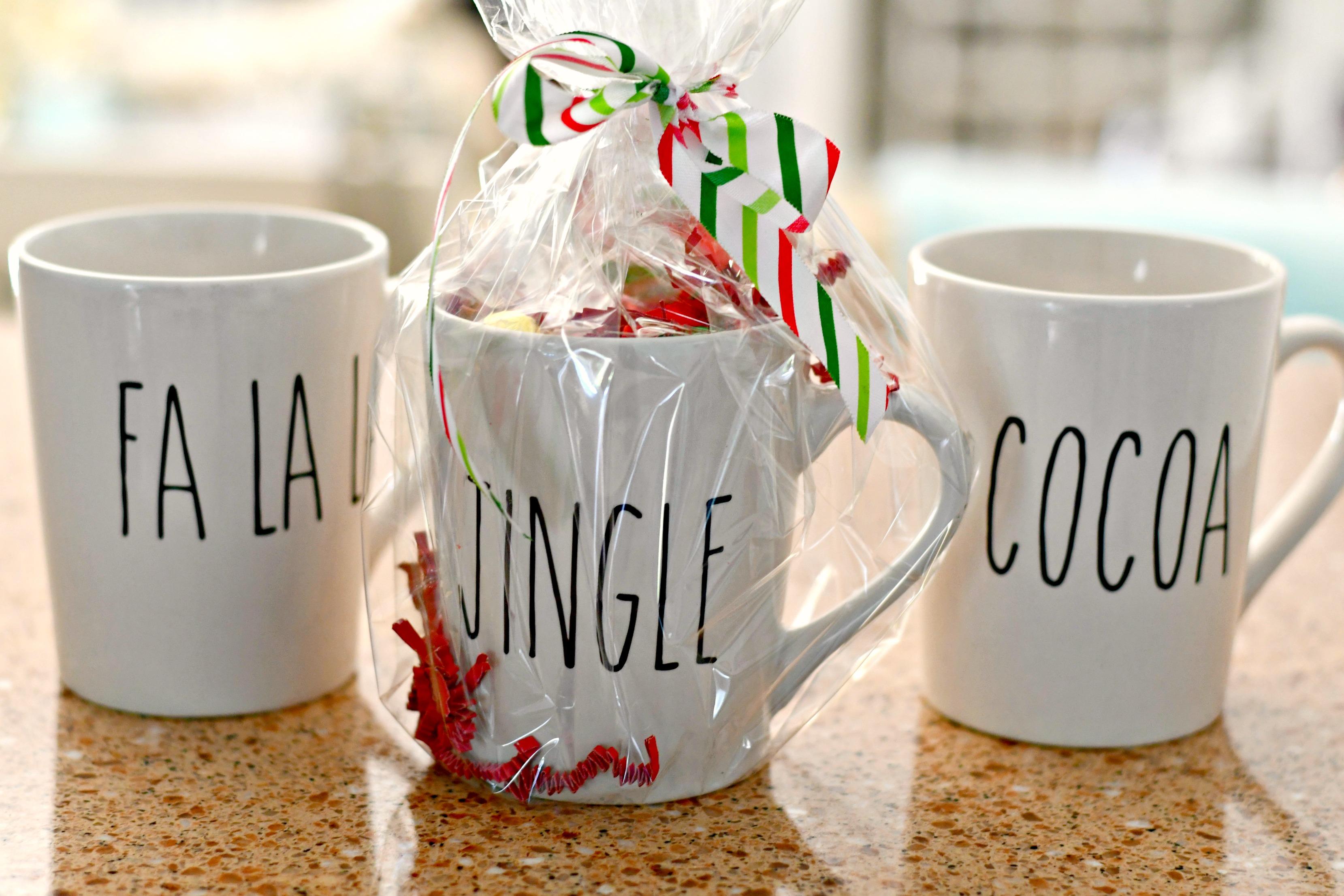 rae dunn christmas dollar tree – cellophane packaging filled mugs as gifts
