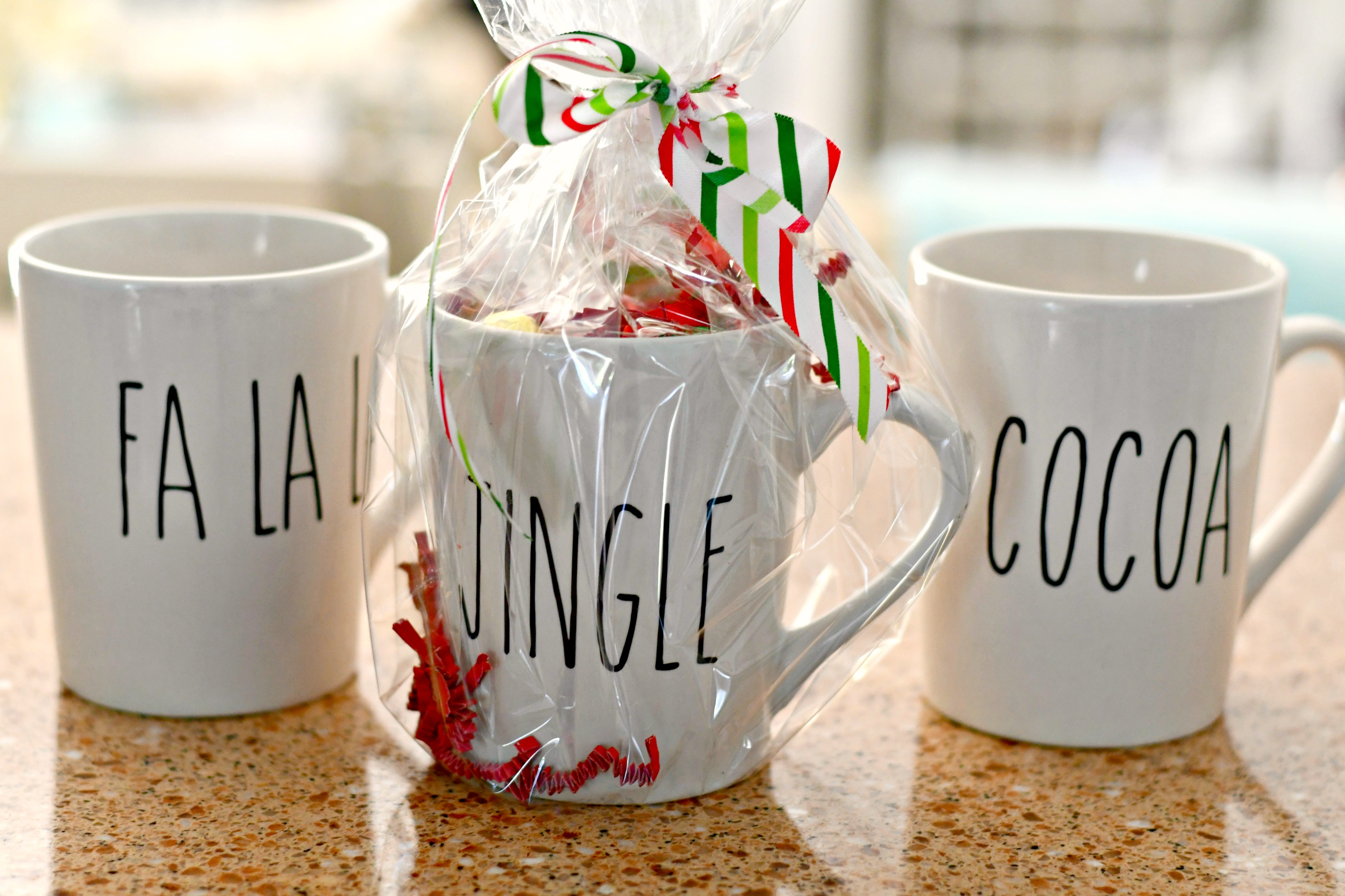rae dunn christmas dollar tree – cellophane packaging filled mugs as gifts