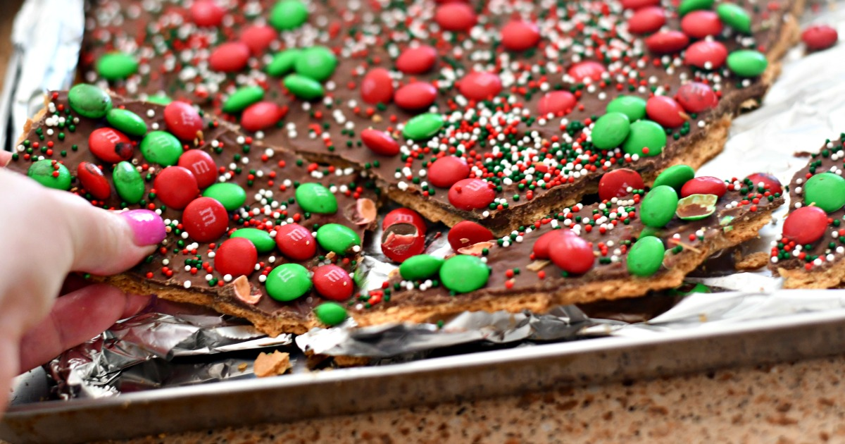 homemade christmas crack toffee – closeup of the toffee being broken apart in the pan