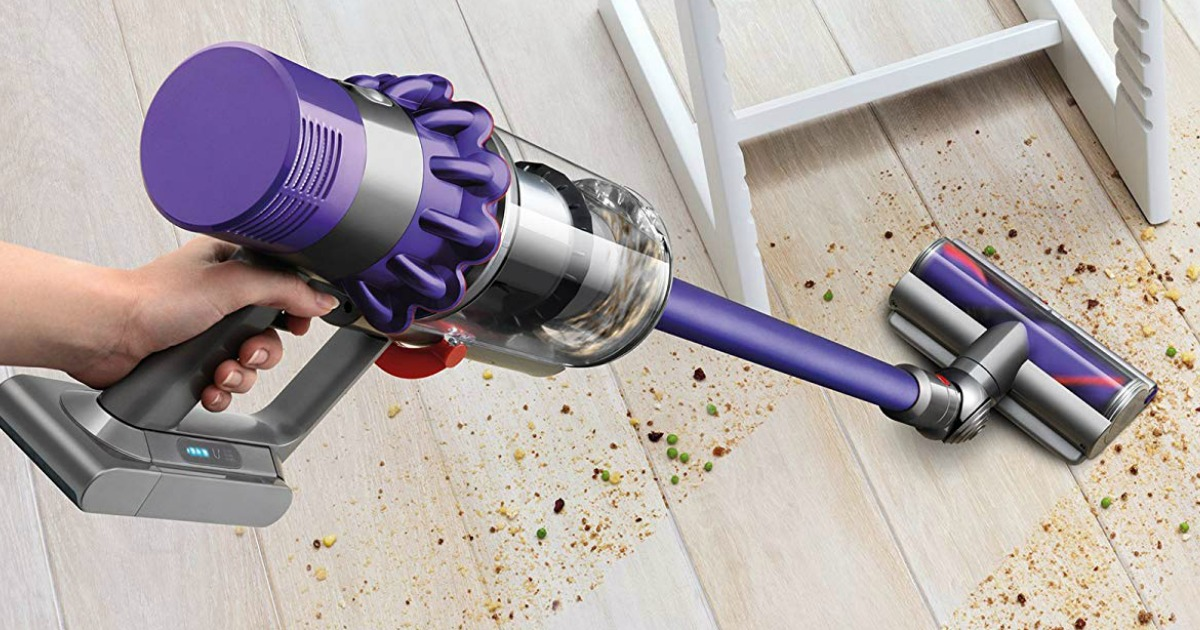 hand held Dyson Cyclone V10 Vacuum cleaning dirt from a floor